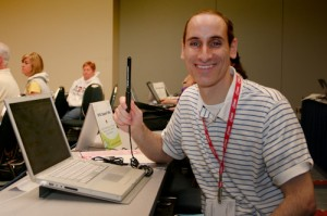 Simpson holds a humidity probe during the Information Technology in Science Instruciton workshop.